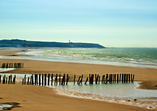 French Atlantic Coast Landscape of French Atlantic Coast with Wooden Breakwaters Outdoors near Sangatte, France manche stock pictures, royalty-free photos & images