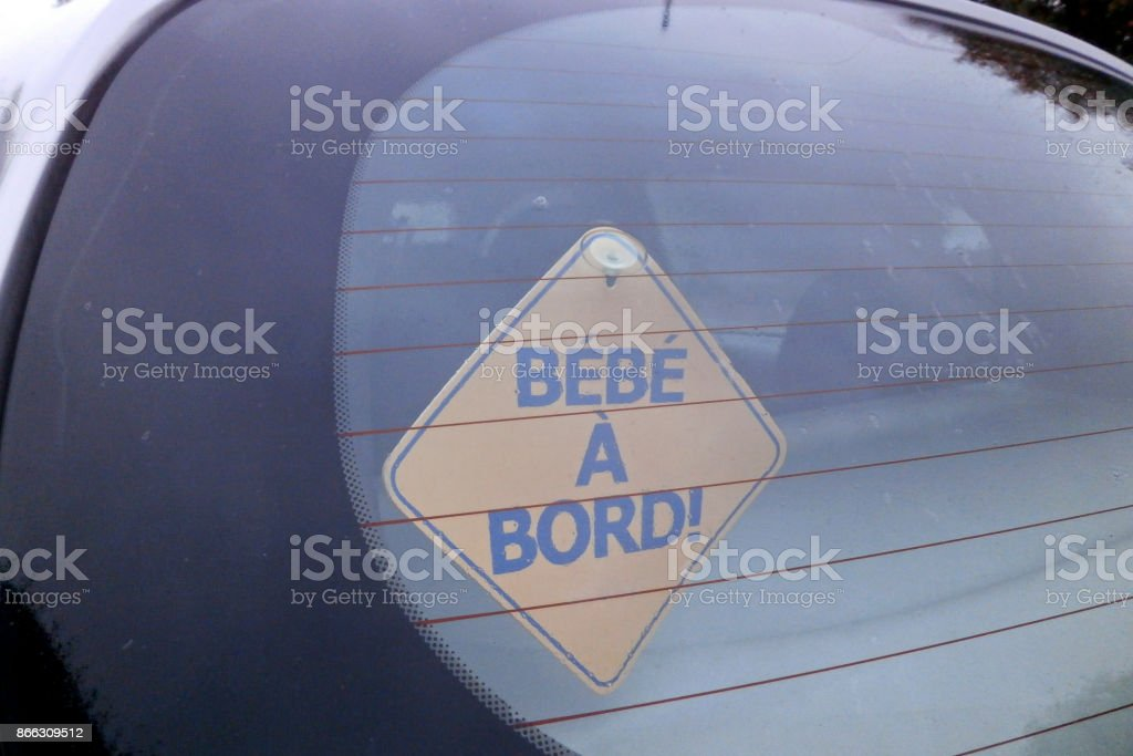 French Baby on board yellow car Sticky sign stock photo