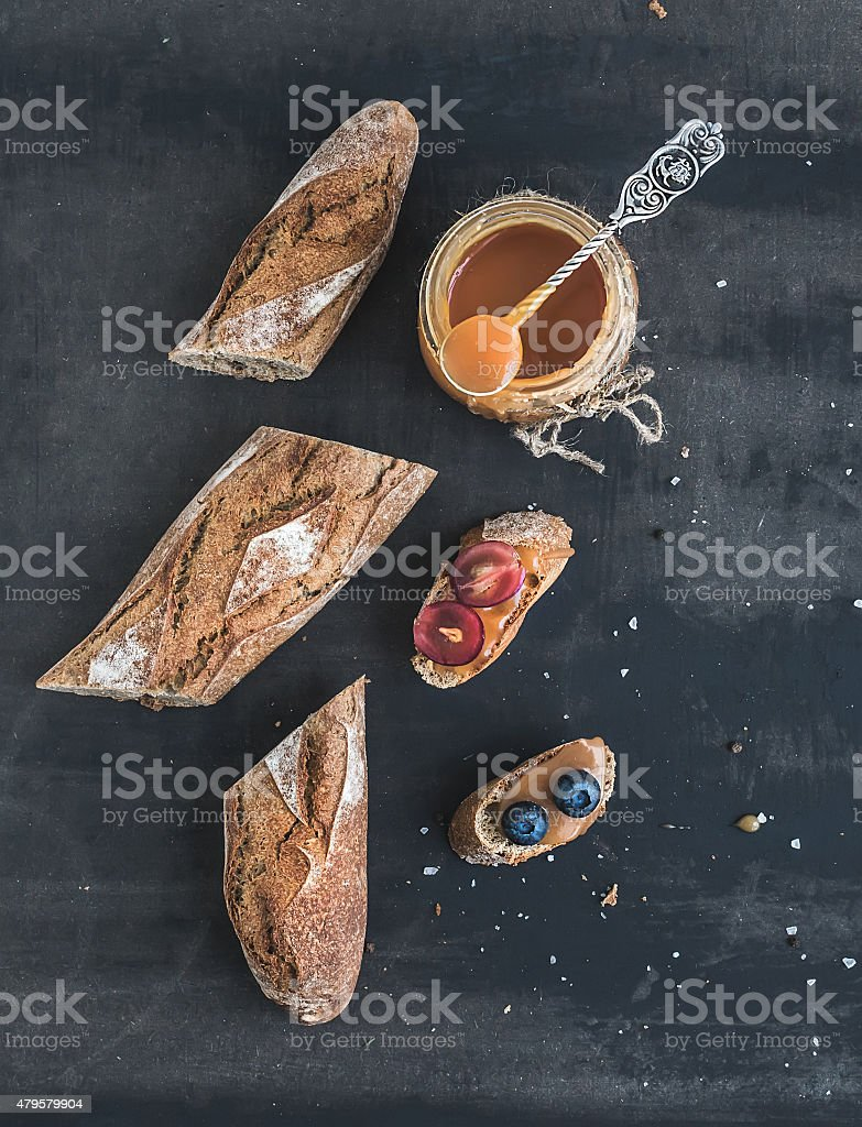 French baguette cut into pieces, sandwiches with red grapes stock photo