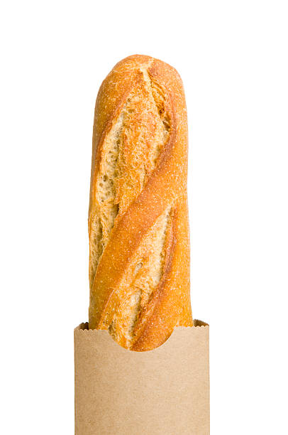 A French baguette in a brown paper bag stock photo