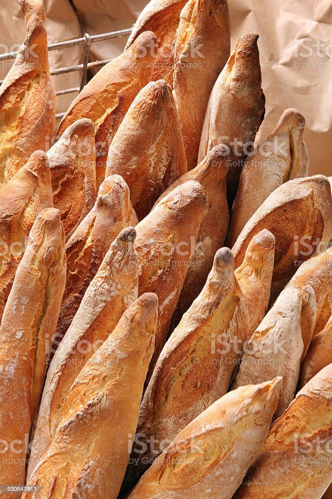 French baguettes in metal basket in bakery stock photo