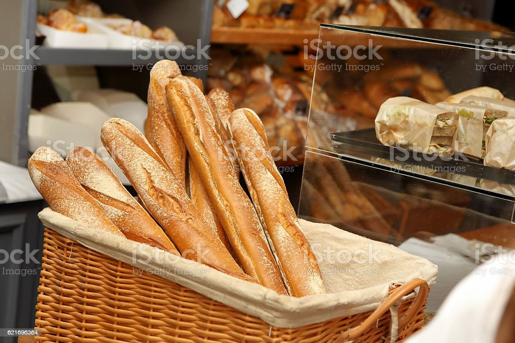 French baguettes in wicker basket in bakery stock photo