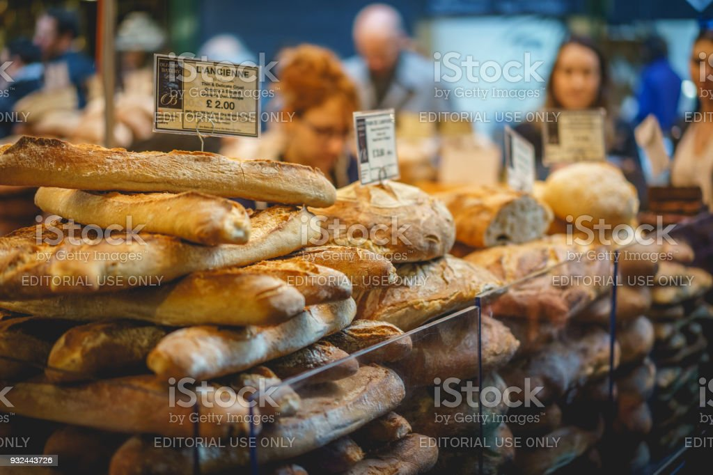 French baguettes on sale in a bakery stall in Borough Market in London (UK). stock photo