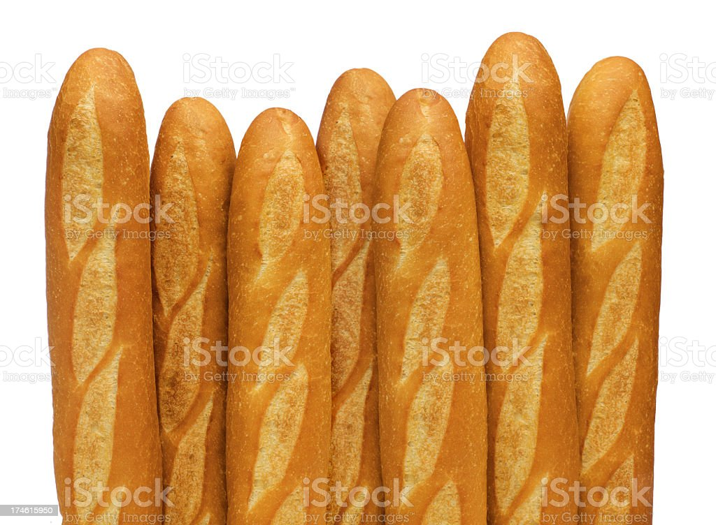 French baguettes stand vertically against a white backdrop royalty-free stock photo