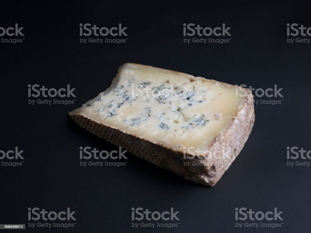 french blue cheese from cows milk on black background stock photo