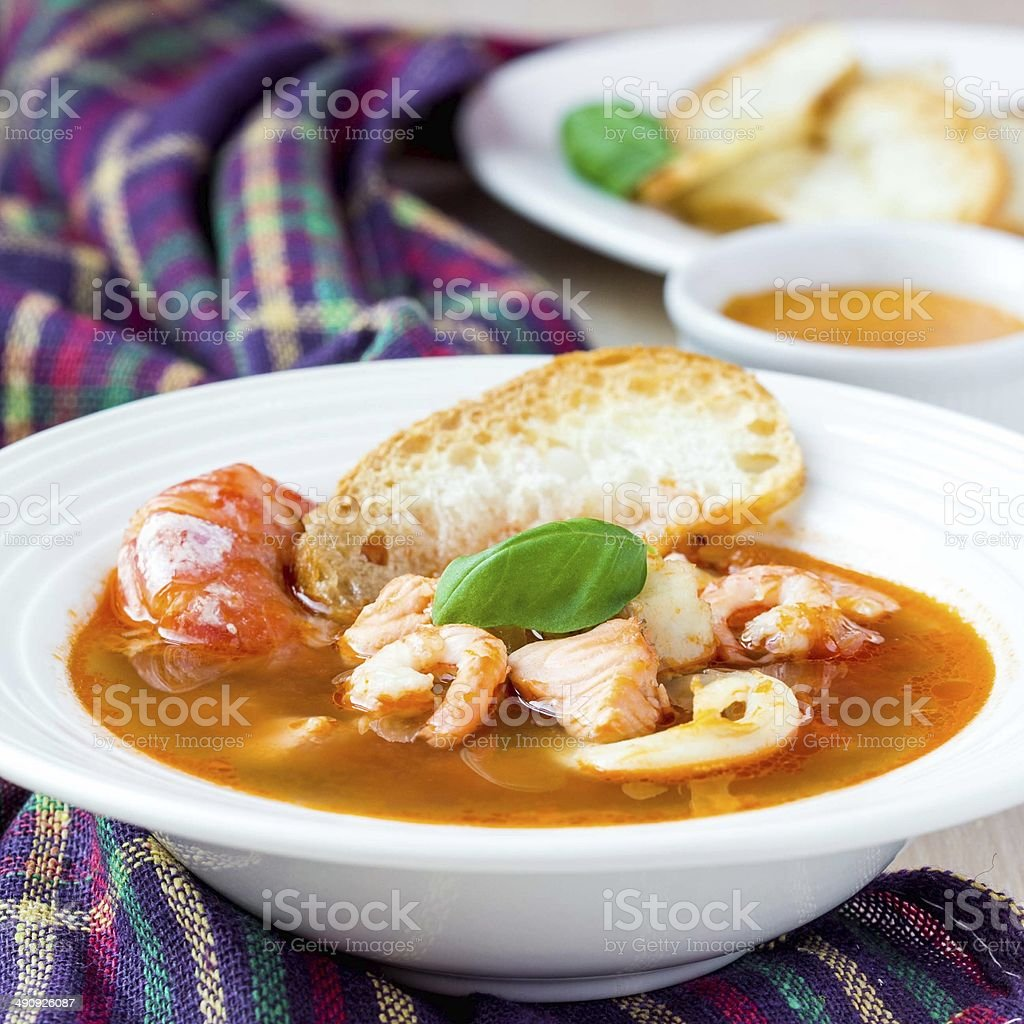 French Bouillabaisse fish soup with seafood, salmon, shrimp stock photo