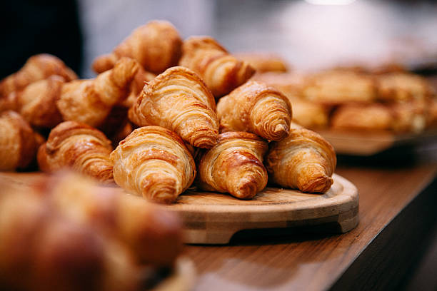 french boulangerie - fresh croissant for sale - bakery stockfoto's en -beelden