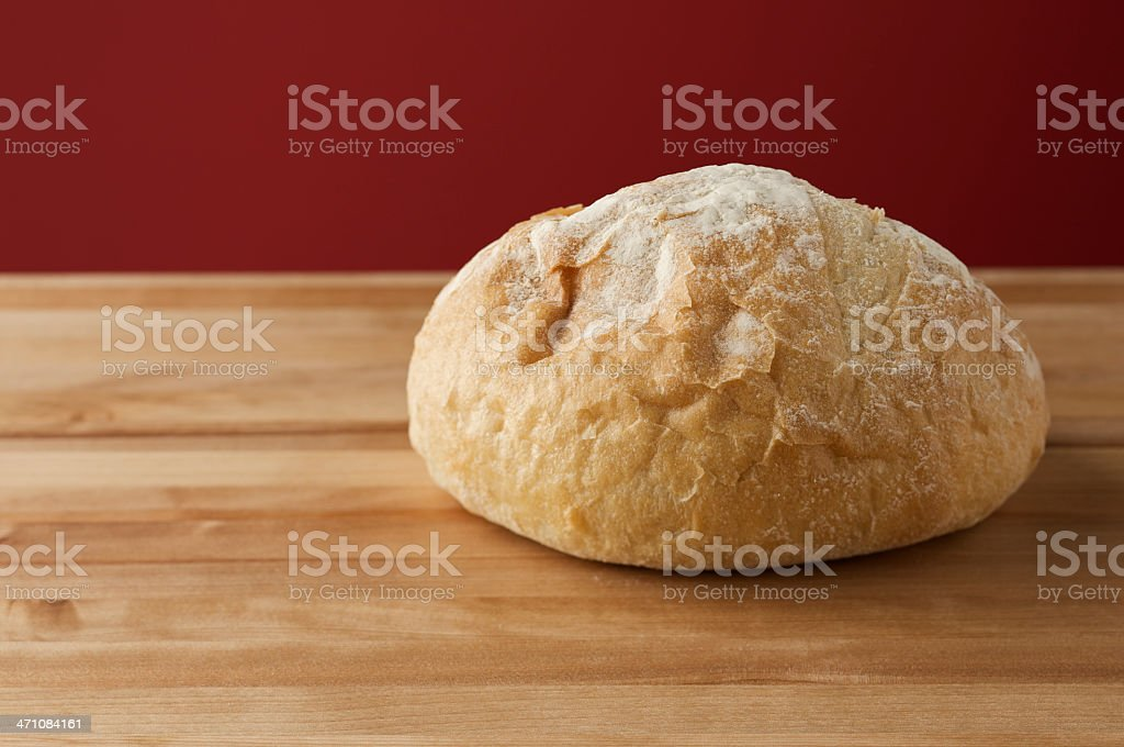 French Boule Bread on wood block stock photo