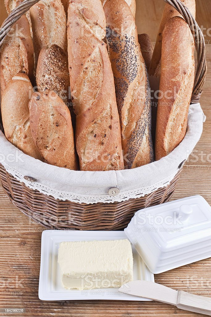 French bread and block of fresh butter stock photo