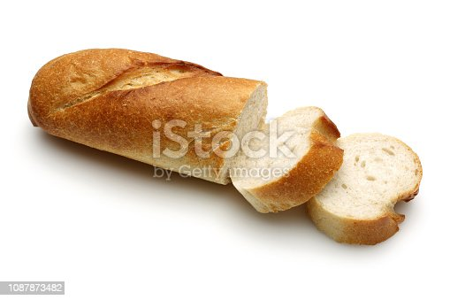 French bread, baguette with slices isolated on white background. Studio shot
