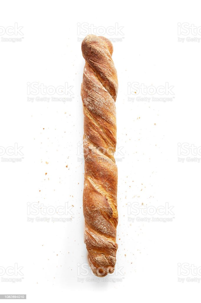 French bread isolated on a white background. Whole baguette and crumbs viewed from above. Top view stock photo