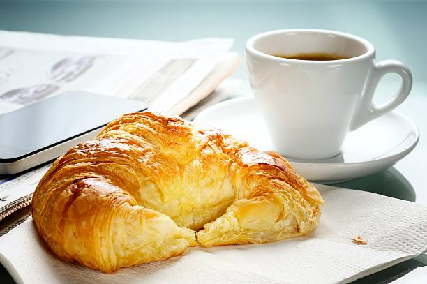 French Breakfast Coffee and Croissant stock photo