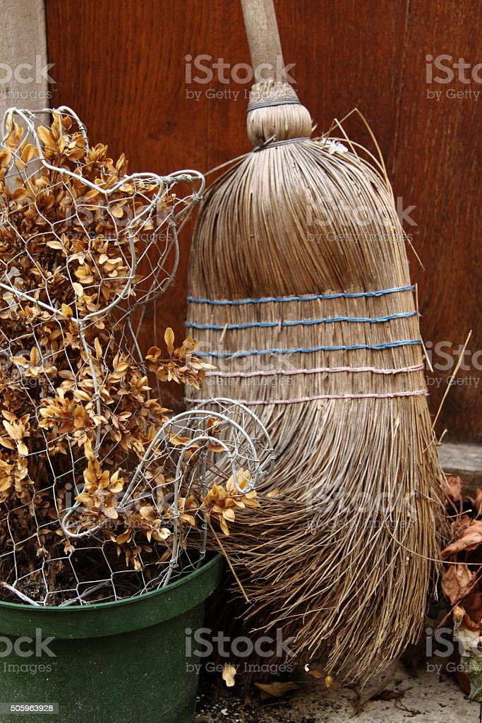 French broom and leaf sweepings in the autumn stock photo