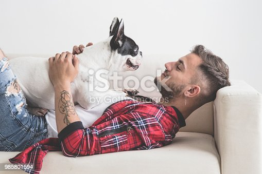 istock French Bulldog dog with affectionate attitude with his owner 985801594