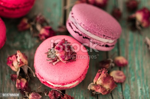 istock French cake macaroon on a wooden background. Colorful dessert 923788608