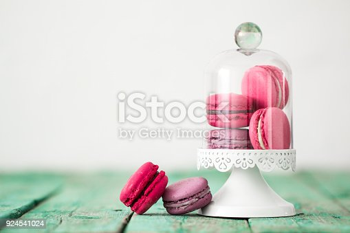 istock French cake macaroon on a wooden background. Colorful dessert 924541024