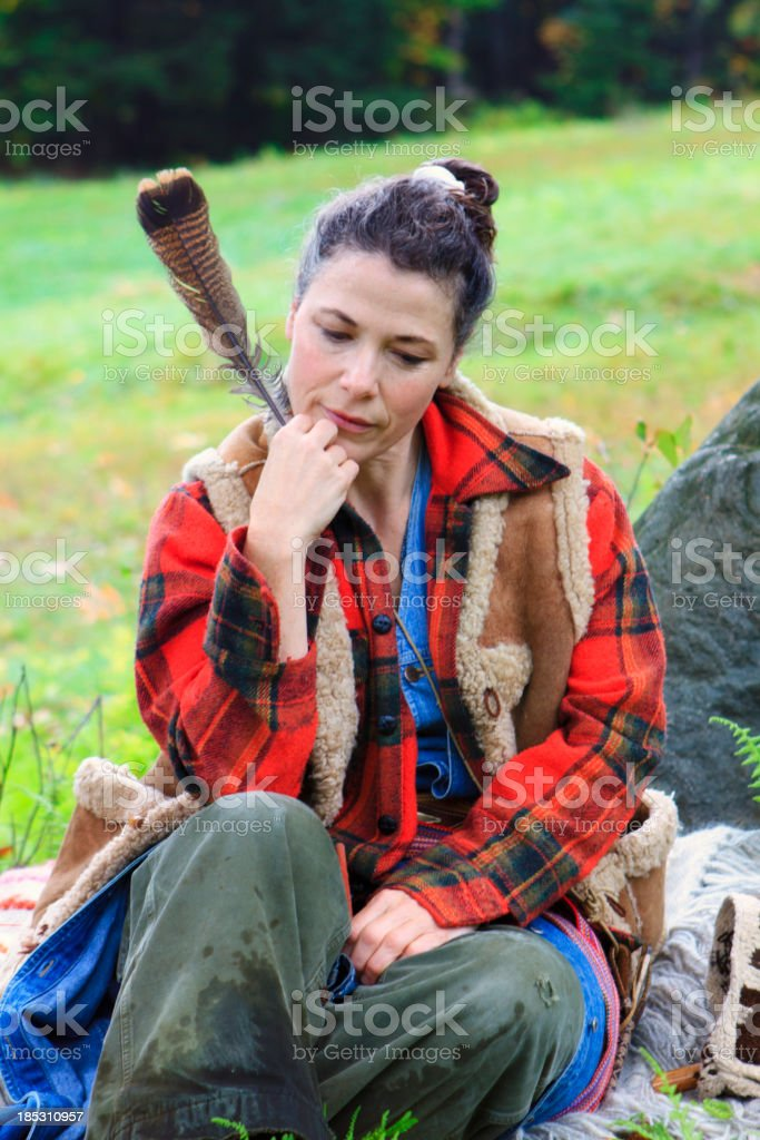 French Canadian Woman telling A Story On The Mountain stock photo