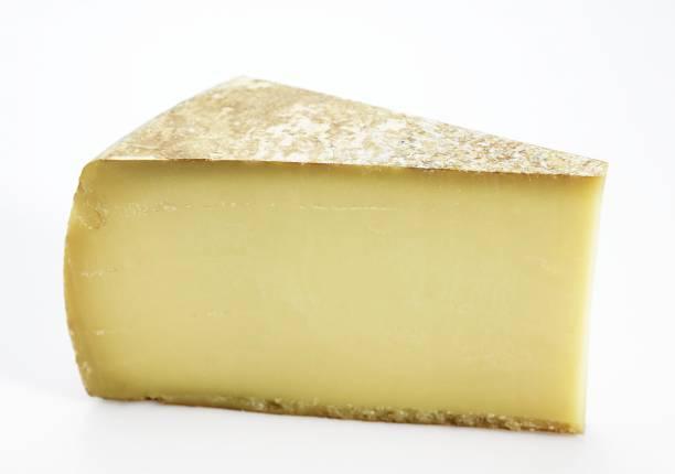 french cheese called comte fruite, cheese made from cow's milk - ser comte zdjęcia i obrazy z banku zdjęć