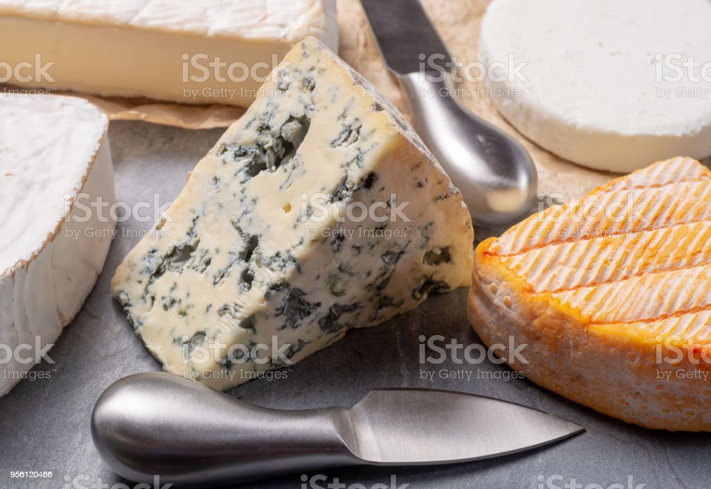 French cheeses plate in assortment blue cheese brie munster soft goat cheese & French Cheeses Plate In Assortment Blue Cheese Brie Munster Soft ...