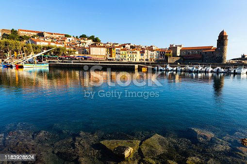 View of picturesque French coastal village Collioure in Mediterranean bay with ancient Church of Our Lady of Angels