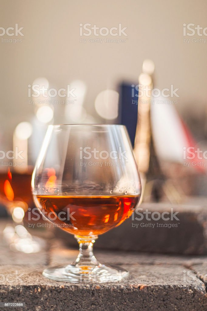 French cognac in glass with French elements stock photo