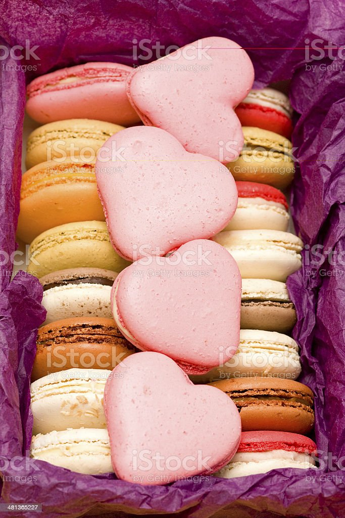 French colorful macarons with hearts in box royalty-free stock photo