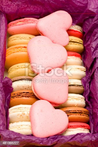 183269671 istock photo French colorful macarons with hearts in box 481365227