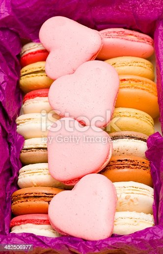 183269671 istock photo French colorful macarons with hearts in box 482506977