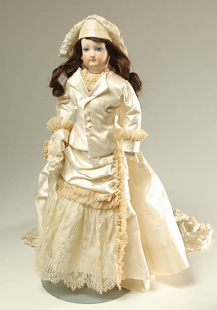 French  Doll in Ivory Dress, 19th Century 1880's French doll in ivory dress, full length portrait. 1880 stock pictures, royalty-free photos & images