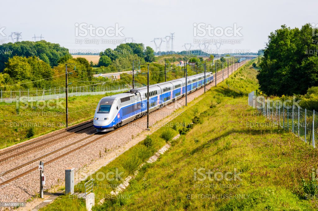 A french double-decker high-speed TGV Duplex train driving north to Paris on the Lyon-Paris high-speed line stock photo