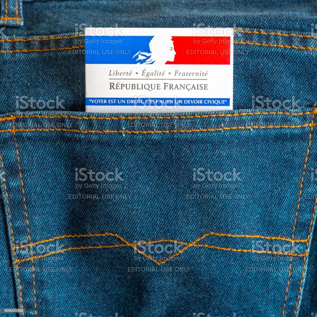 French electoral voter card official government allowing to vote paper close-up in jeans back pocket stock photo