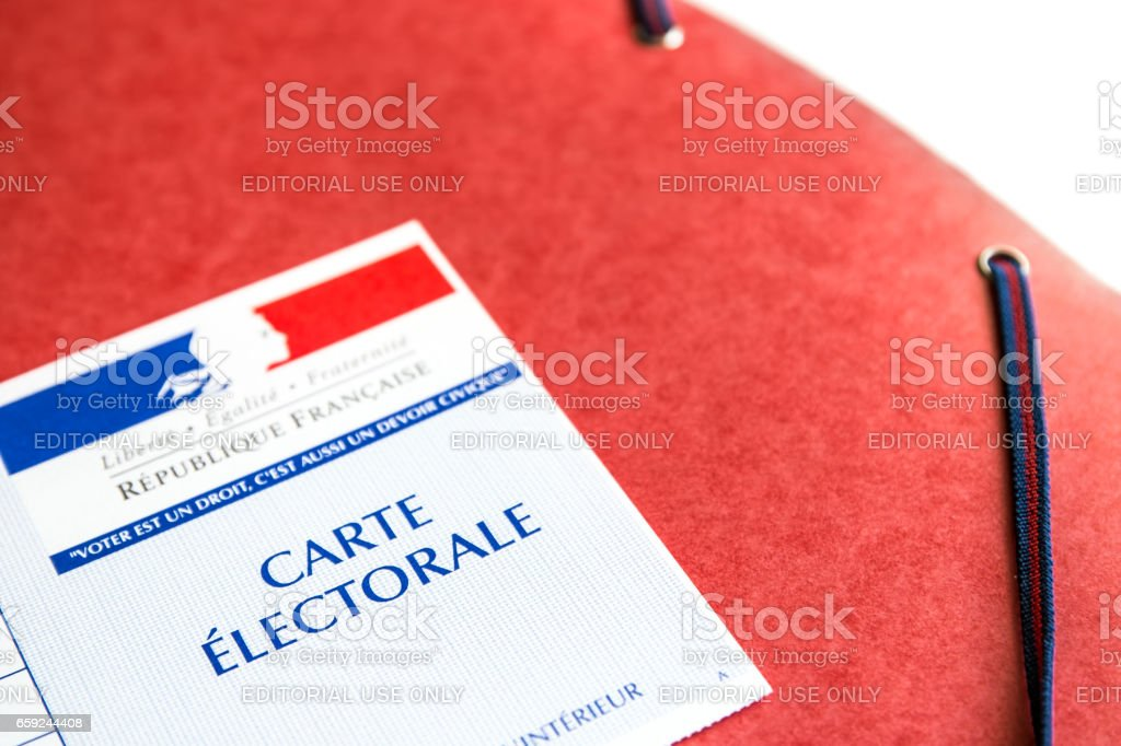 French electoral voter card official government allowing to vote paper close-up on red cardboard file stock photo