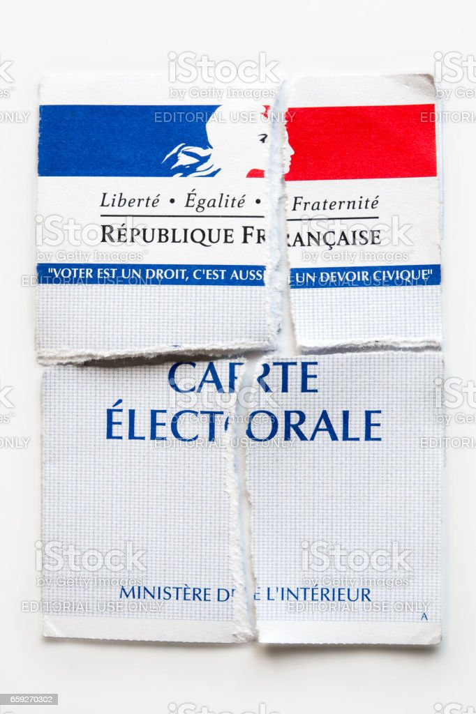 French electoral voter card official government allowing to vote paper close-up torn in four pieces on white background stock photo