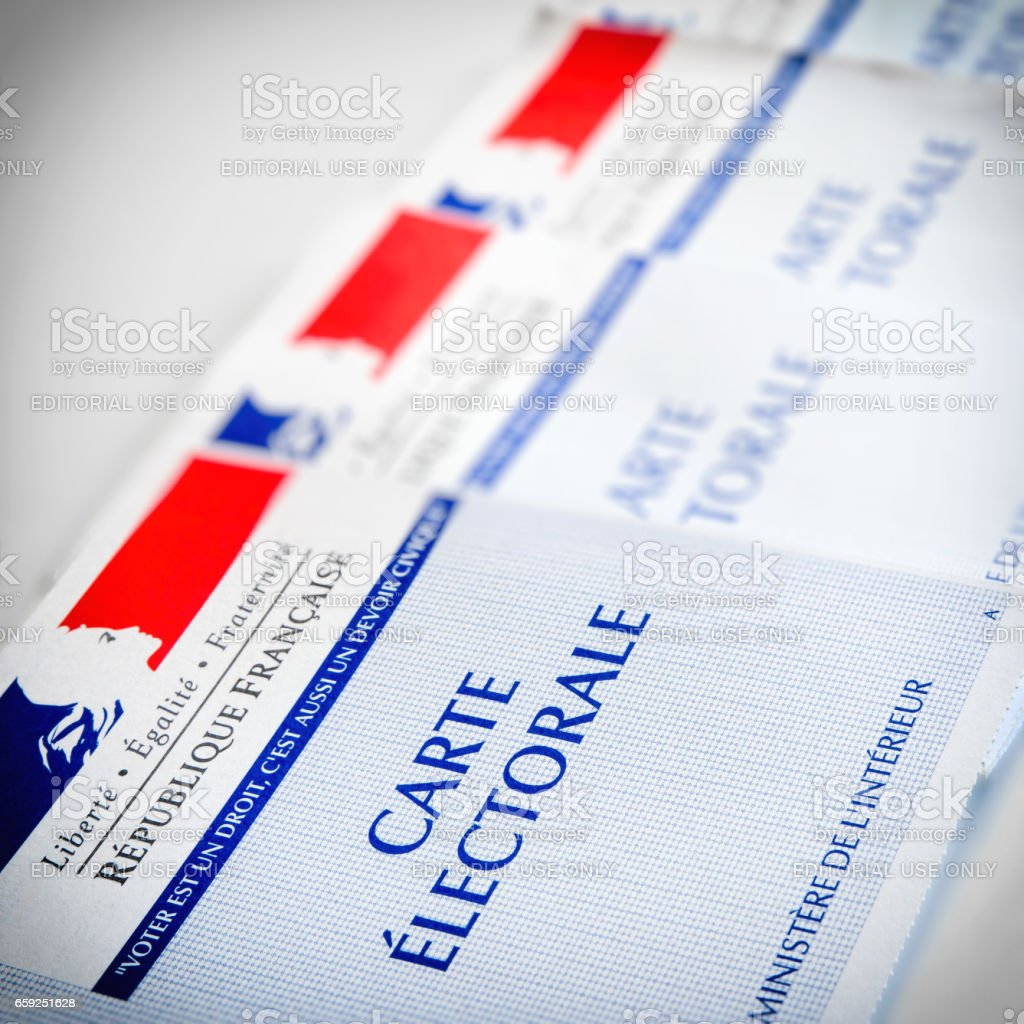 French electoral voter cards official government allowing to vote paper close-up placed in a row on a white table stock photo