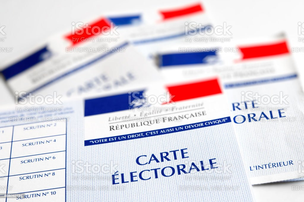 French electoral voter cards official government allowing to vote paper close-up placed on white bright table stock photo
