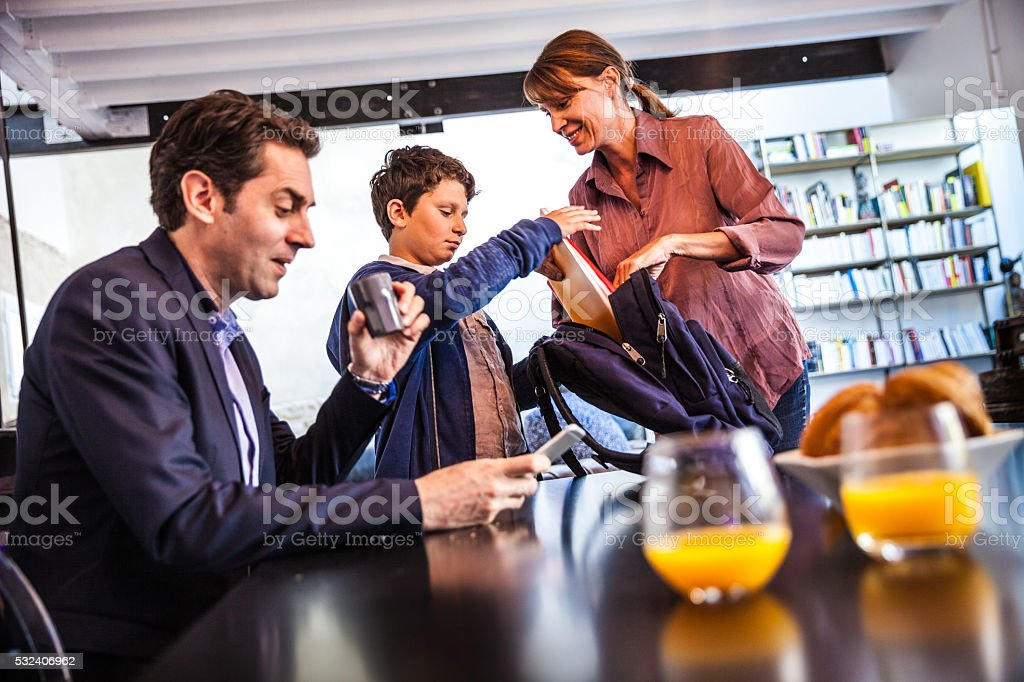 French family in the morning prep for school and breakfast stock photo