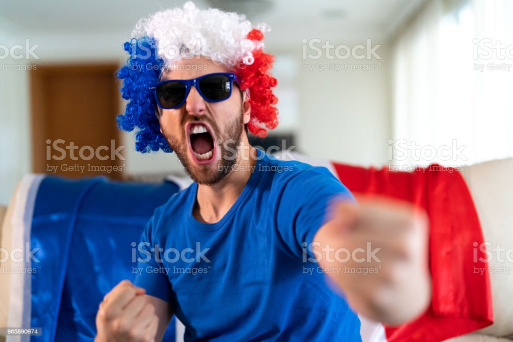 French fan celebrating at home - Royalty-free Adult Stock Photo