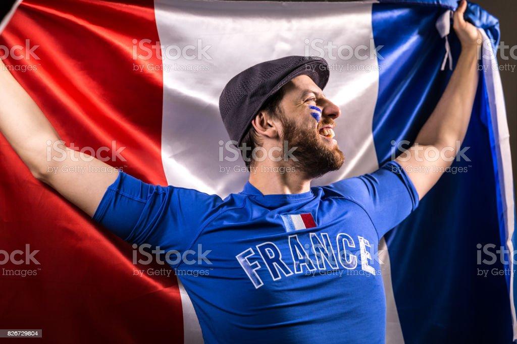 Fan Français tenant le drapeau national - Photo