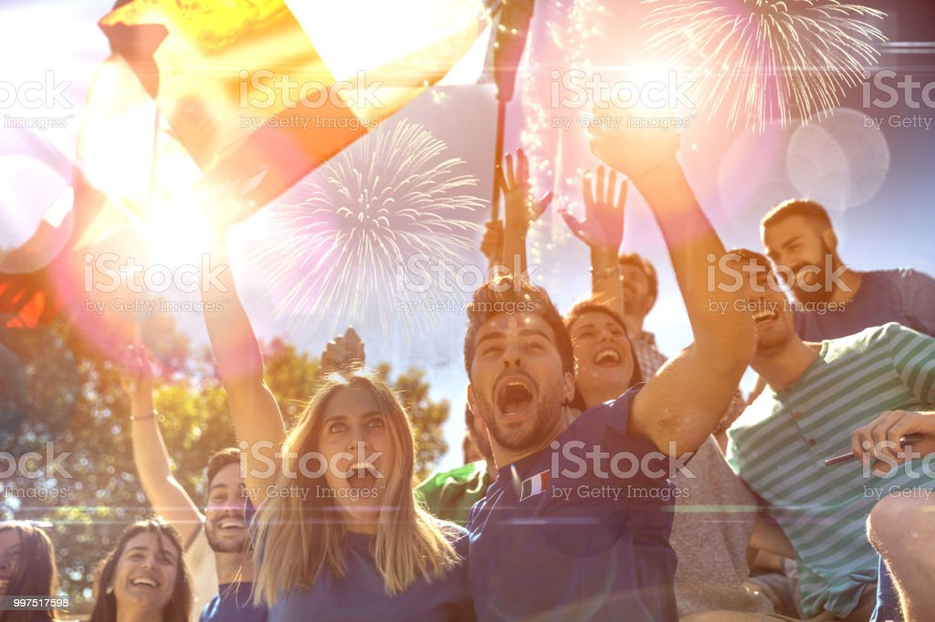 French fans watching and supporting their team at world competition football league stock photo