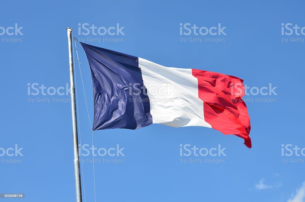 French Flag Blowing in the Wind stock photo