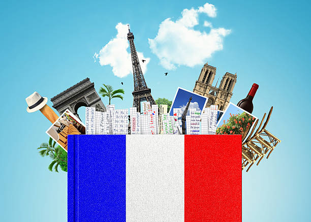 A French flag language book with French themed items at top stock photo