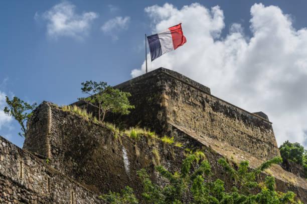 french flag on a top of fort saint louis in fort-de-france, martinique - st louis стоковые фото и изображения