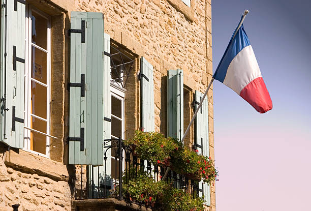 French flag on building stock photo