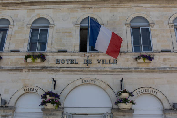 French flag waving over one city hall French flag waving over one city hall ville stock pictures, royalty-free photos & images