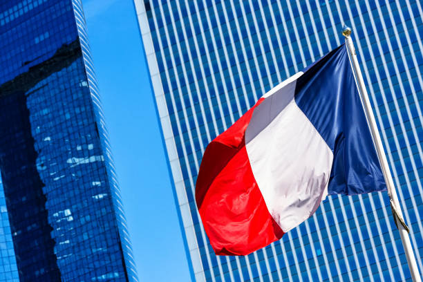 French flag with business building on background stock photo