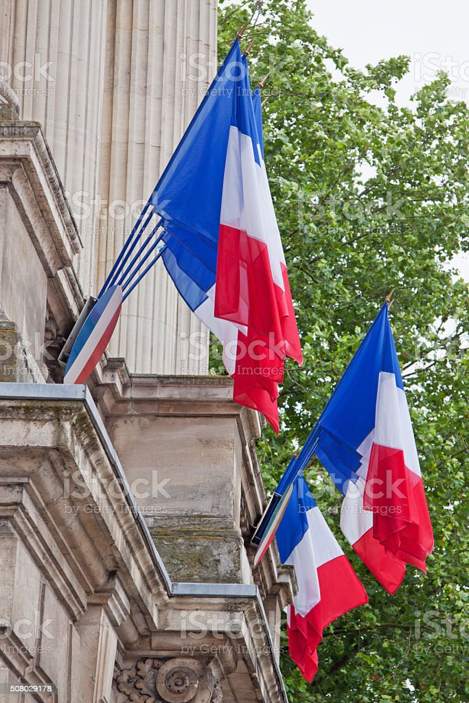 French flags flying on a government building on Bastille Day stock photo