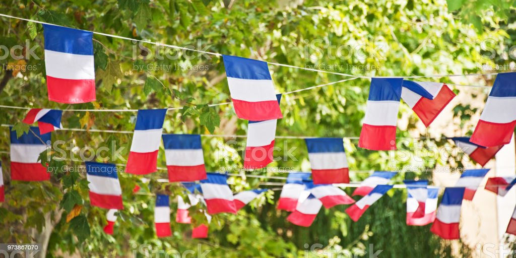French flags garland decorating a village square stock photo