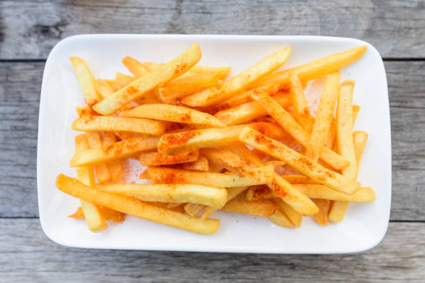 French Fried with Cayenne pepper on top stock photo