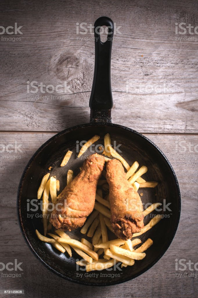 French fries and chicken legs stock photo