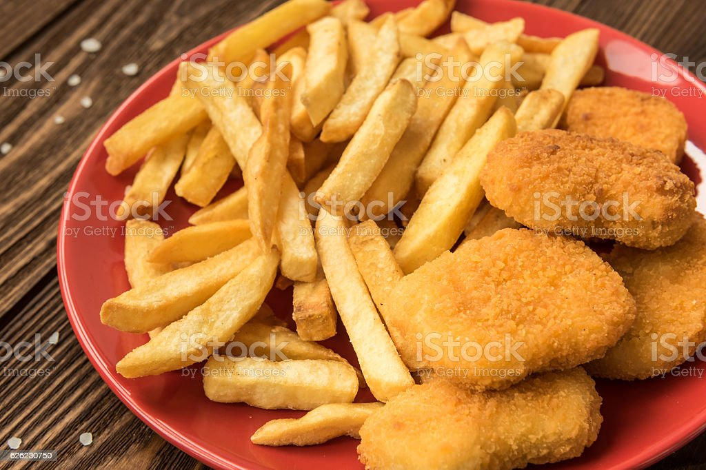 French fries and chicken nuggets stock photo